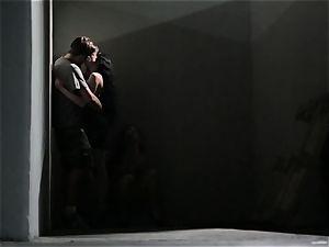 Asa Akira masturbates as she watches a kinky duo