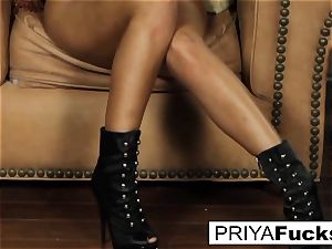 Priya satisfies her thirst with a plaything