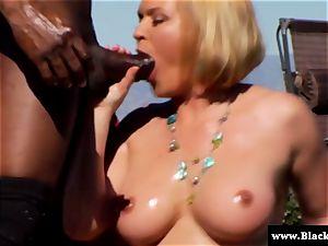 chesty Krissy Lynn sucking big black cock outdoors in the sun