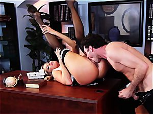 The maid grinds his pipe with her puss