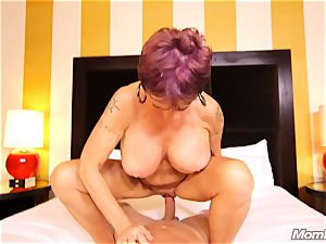 big-boobed Russian GILF rockets all over cock