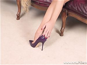 light-haired strips off lingerie and solos in nylons and high-heeled shoes