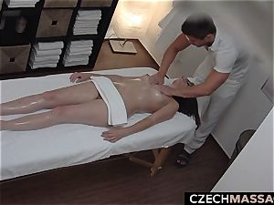 dark-haired with Glasses Seduced on massage Table
